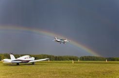 Airplane landing. Rainbow over the sky. Kozelsk russia Stock Photo