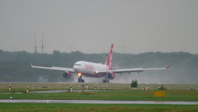 Airplane landing at rainy weather stock video
