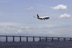 Airplane landing in Rio De Janeiro Stock Images