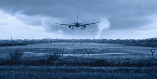 Airplane landing. On the runway with rain Stock Photo