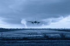 Airplane landing Stock Image