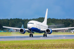 Airplane landing on runway. Touchdown with tire smoke royalty free stock photography