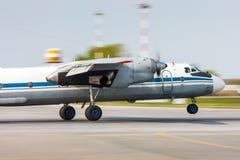 Airplane landing on runway. Turboprop airplane landing on runway stock image