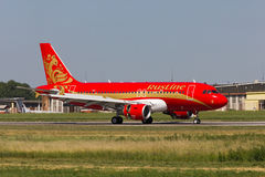Airplane A319 landing. Landing of the Ruslin aircraft A319, painted by the Khokhloma painting, Rostov-on-Don, Russia, June 20, 2012 Stock Photo