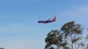 Airplane landing at San diego airport stock footage