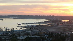 Airplane landing at San diego airport stock video footage