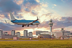 Airplane landing on Schiphol airport in Amsterdam Netherlands Royalty Free Stock Image