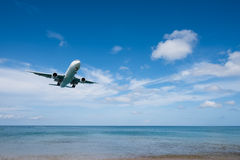 Airplane landing from sea to airport. Airplane prepare for landing at airport near the sea Royalty Free Stock Image