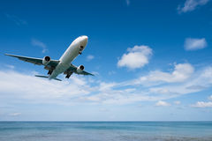 Airplane landing from sea to airport. Airplane prepare for landing at airport near the sea stock image