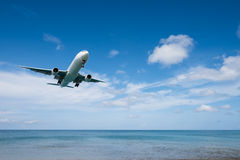 Airplane landing from sea to airport. Airplane prepare for landing at airport near the sea royalty free stock photos