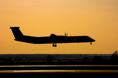 Airplane landing silhouette Stock Image