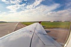 Airplane on landing strip Royalty Free Stock Images