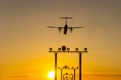 Airplane landing during sun Royalty Free Stock Photos
