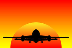 Airplane landing at sunset Royalty Free Stock Images