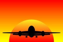 Airplane landing at sunset Royalty Free Stock Images