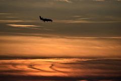Airplane landing at sunset Royalty Free Stock Photography