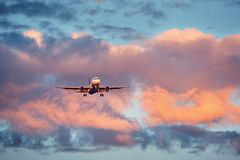 Airplane landing at the sunset Royalty Free Stock Photo