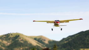 Airplane Landing Tilt Shift Royalty Free Stock Photos