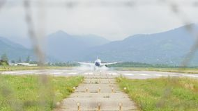 Airplane landing to the airport in mountains - Georgia.  stock video