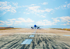 Airplane landing to runway. In airport Royalty Free Stock Photos