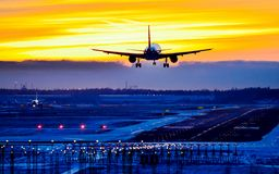 Airplane landing to runway. Silhuette view of an airplane approach for landing Stock Photography