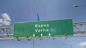Airplane Landing Varna. Airplane flying over airport signboard stock video