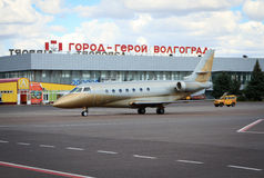 Airplane landing at Volgograd airport. Volgograd, Russian Federation, August 07,2015: Airplane landing at the Airport terminal in Volgograd city royalty free stock photos