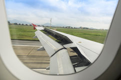 Airplane is landing. The wing is moving up when airplane is landing to runway Royalty Free Stock Image