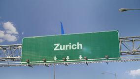 Airplane Landing Zurich. Airplane flying over airport signboard stock video