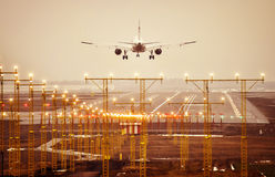 Airplane lands to airport runway foggy day. Airplane lands to airport runway Royalty Free Stock Images