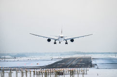 Airplane lands to airport runway Royalty Free Stock Photography