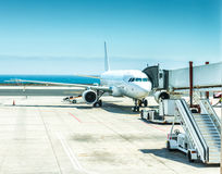 Airplane in Lanzarote airport. With blue sea and sky on the background Royalty Free Stock Image
