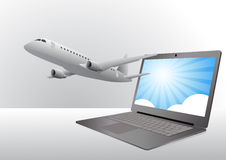 Airplane and laptop Stock Image