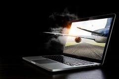 Airplane in laptop screen. Mixed media Stock Photos