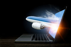 Airplane in laptop screen. Mixed media Royalty Free Stock Image