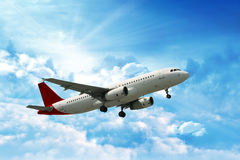 Airplane. Large passenger plane flying in the blue sky Royalty Free Stock Images