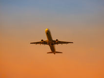 Airplane leaving airport at the sunset Royalty Free Stock Photography
