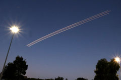Airplane light trail. Long exposure light trail of airplane taking off Royalty Free Stock Photo