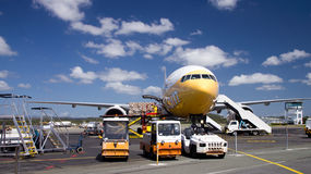 Airplane loading cargo. Royalty Free Stock Photo