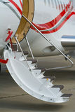 Airplane low air-stairs Stock Photography
