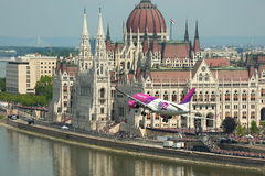 Airplane low pass in Budapest royalty free stock image