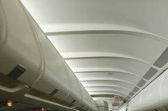 Airplane luggage space. Luggage conteiners on the roof of airplane Royalty Free Stock Photos