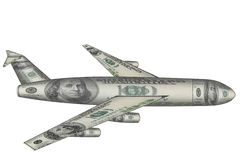 Airplane made from dollars flying over white Stock Photo