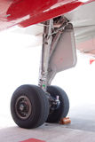 Airplane main landing gear. The main landing gear assembly under the wing from a mid range passenger jet with the two wheels cables, tubes and the gear door Royalty Free Stock Image