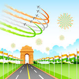 Airplane making Indian tricolor flag around India Gate Stock Photos