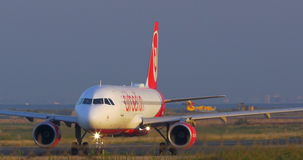 Airplane making a turn on runway. THESSALONIKI, GREECE - AUGUST 15, 2015: Airplane moving on the take-off strip and then making a turn. Airberlin is the second stock video