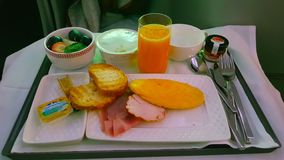 Breakfast in the business class of an airplane. In airplane - March, 2018. Breakfast in the business class of an airplane flight to Chile royalty free stock image