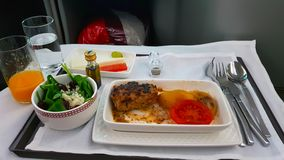 Dinner in the business class of an airplane flight to Chile royalty free stock photography