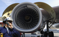 Airplane mechanic and jet engine Royalty Free Stock Photo