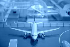 Airplane miniature at airport Royalty Free Stock Image